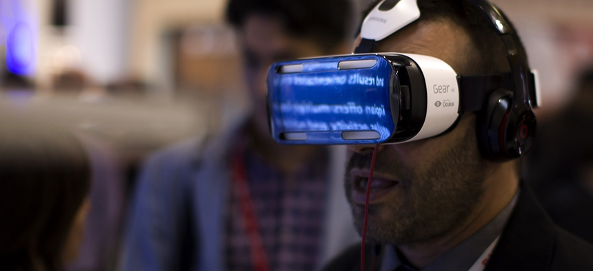 A visitor uses a Samsung virtual reality glasses during the Mobile World Congress Wireless show.