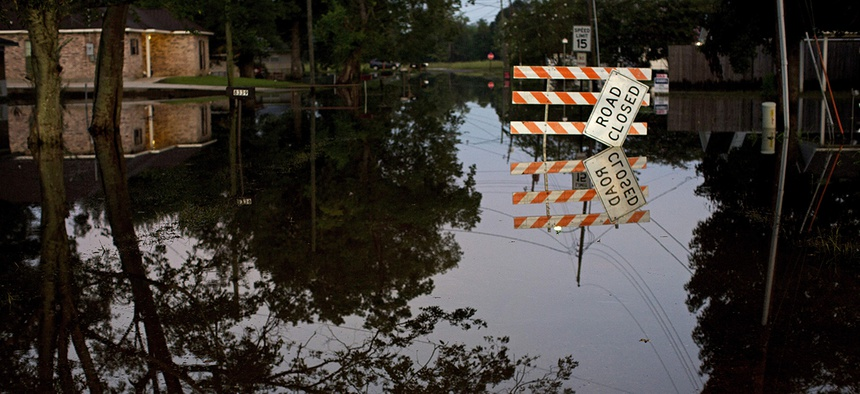 Standing water closes roads in Sorrento, La., Saturday, Aug. 20, 2016.