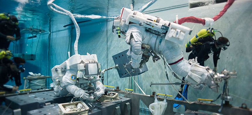 NASA astronaut Terry Virts simulates extravehicular activity in the Johnson Space Center's Neutral Buoyancy Laboratory.