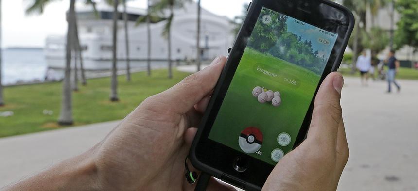 Pokemon Go player hunts for Pokemon at Bayfront Park in downtown Miami.