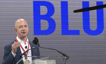 Amazon CEO Jeff Bezos addresses reporters and guests during a news conference unveiling the new Blue Origin rocket at the Cape Canaveral Air Force Station.
