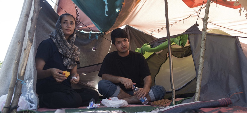 Azada Sayed, 23, left, and her husband, Hameed, 28, sit in their tent at a makeshift camp for migrants and refugees situated meters away from the Serbian border with Hungary, in Horgos, Serbia.