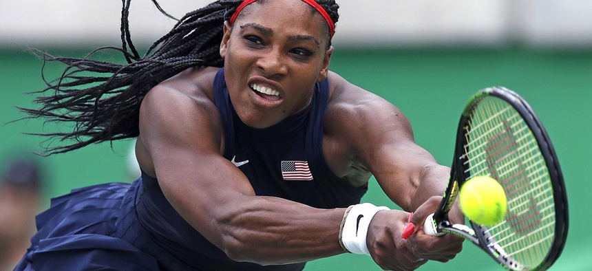 Serena Williams, of the United States, reaches for a return against Daria Gavrilova, of Australia, at the 2016 Summer Olympics in Rio de Janeiro, Brazil.