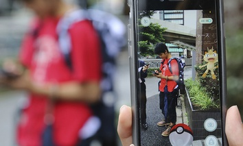 "Japanese students play ""Pokemon Go"" in the street as its released in Tokyo."