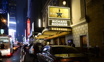 "People walk by the ""Hamilton"" marquee at the Richard Rogers Theatre on Saturday, July 9, 2016, in New York."