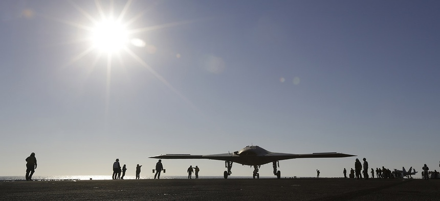 The Navy experimental unmanned aircraft, the X-47B, taxies to it's launch position on the flight deck aboard the nuclear powered aircraft carrier USS Theodore Roosevelt.