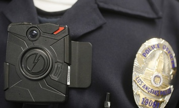 A Los Angeles Police officer wears an on-body camera during a demonstration in Los Angeles.