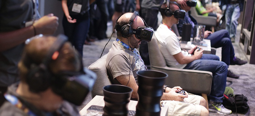 People try out the Oculus Rift virtual reality headsets.