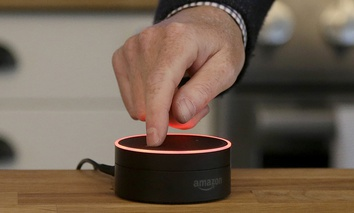 David Limp, Amazon Senior Vice President of Devices, pushes down an Echo Dot in San Francisco.
