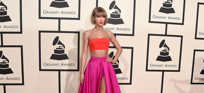 Taylor Swift arrives at the 58th annual Grammy Awards