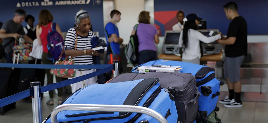 Bags wait to be checked at a Delta Air Lines counter at Baltimore-Washington International Thurgood Marshall Airport.