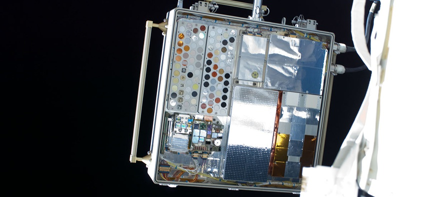 Experiment sample trays on MISSE-8 attached to the exterior of the International Space Station in 2013. These trays held the ionic liquid epoxy samples that could help build composite cryogenic tanks for future spacecraft.