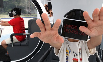 Children wearing the Oculus Rift virtual reality headsets, experience virtual reality technology.