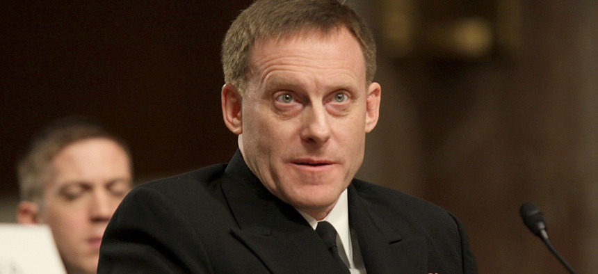 Navy Vice Adm. Michael Rogers testifies on Capitol Hill in Washington.