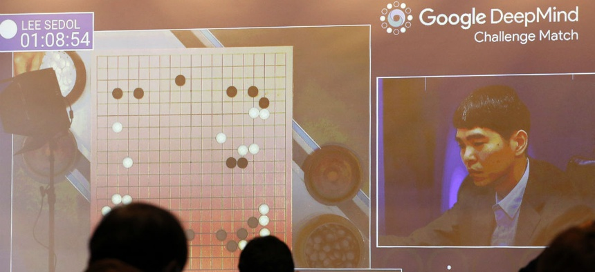 South Korean professional Go player Lee Sedo appears on the screen during the second match of the Google DeepMind Challenge Match against AlphaGo in March 2016.