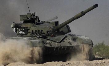 A Ukrainian tank moves at the Desna training center outside Chernihiv, some 80 km north of Kiev, Ukraine, Thursday, Sept. 8, 2016.