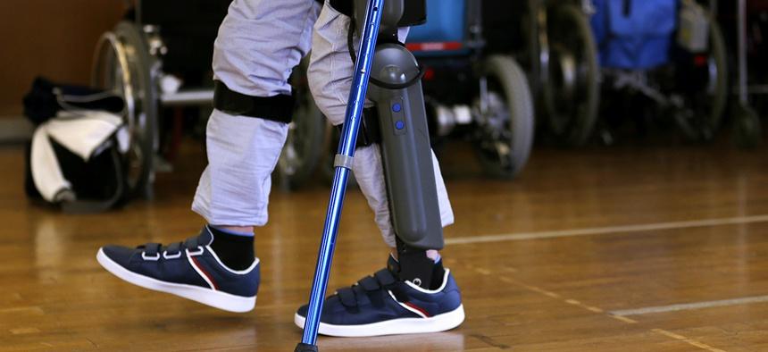 Yuichi Imahata walks using a robotic exoskeleton called ReWalk at Kanagawa Rehabilitation Center in Atgugi, west of Tokyo.