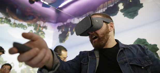 Dan Howley tries out the Google Daydream View virtual-reality headset and controller following a product event, Tuesday, Oct. 4, 2016.
