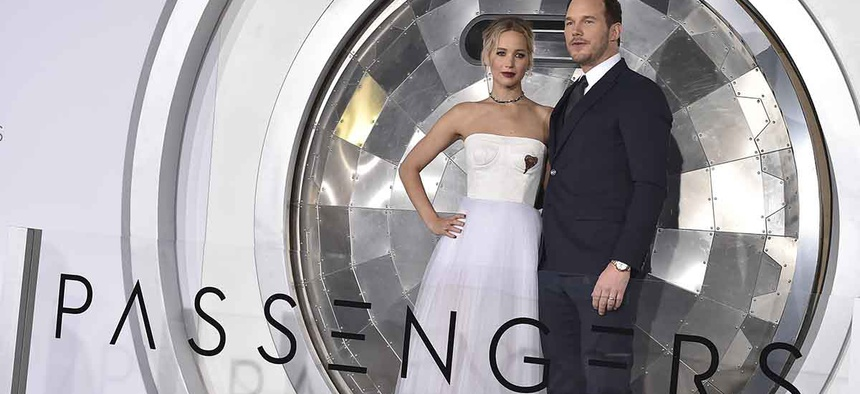 "Jennifer Lawrence, left, and Chris Pratt arrives at the Los Angeles premiere of ""Passengers"" at the Village Theatre Westwood on Wednesday, Dec. 14, 2016."