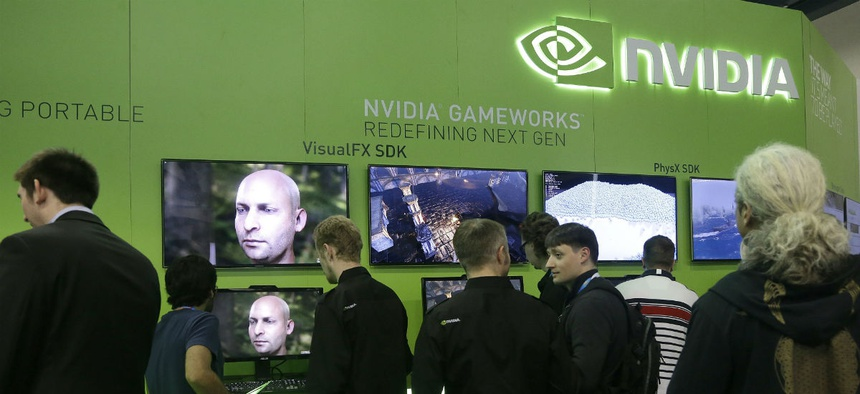 Attendees to the Game Developers Conference 2014 look at screens in the Nvidia booth in San Francisco.