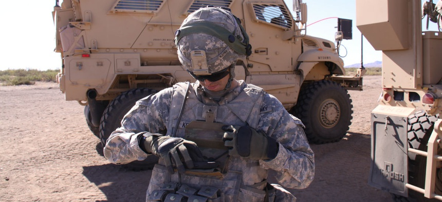 A solider demonstrates a Nett Warrior device.
