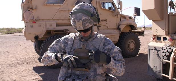A solider demonstrates a Nett Warrior device.