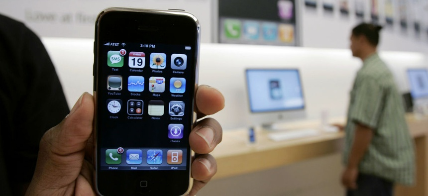 A customer holds an Apple iPhone at the Apple store in Palo Alto, Calif., Friday, Oct. 19, 2007.
