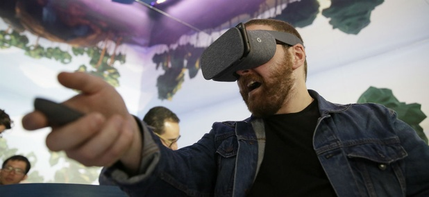 Dan Howley tries out the Google Daydream View virtual-reality headset and controller following a product event, Tuesday, Oct. 4, 2016, in San Francisco.