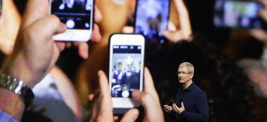 Apple CEO Tim Cook announces the new iPhone 7 during an event to announce new products, in San Francisco.