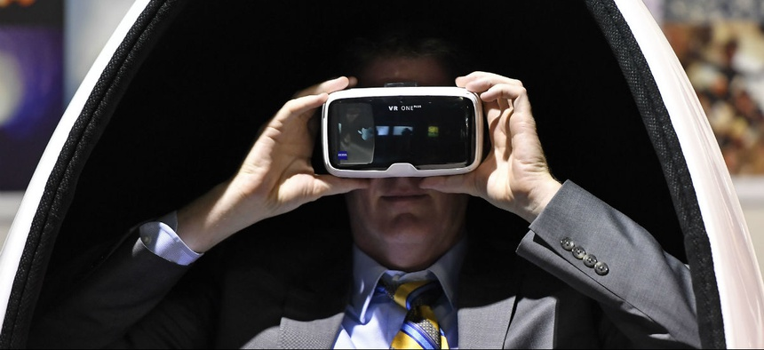 A visitor wears the latest virtual reality goggles at the Photokina in Cologne, Germany, Tuesday, Sept. 20, 2016.
