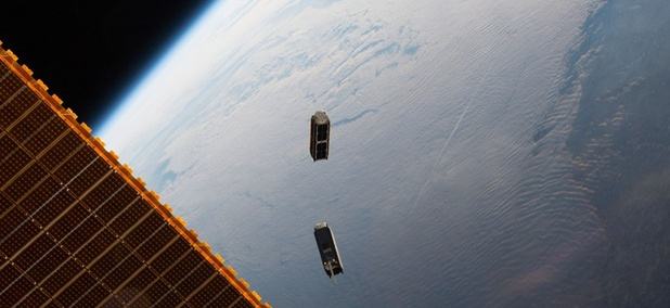 "The International Space Station deploys two Planet ""doves"" in May 2016."