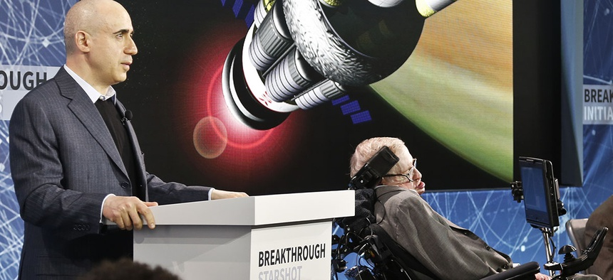 Internet investor and science philanthropist Yuri Milner, left, and renowned cosmologist Stephen Hawking, right, discuss the new Breakthrough Initiative focusing on space exploration and the search for life in the universe.