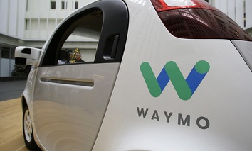 The Waymo driverless car is displayed during a Google event