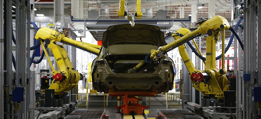 Automated robots build a 2015 Chrysler 200 at the Sterling Heights Assembly Plant in Sterling Heights, Mich.