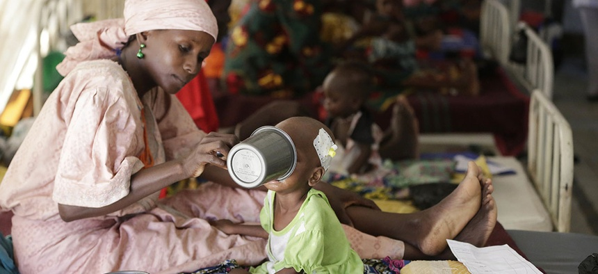 A mother feeds her malnourished child at a feeding centre run by Doctors Without Borders in Maiduguri, Nigeria.