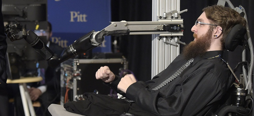 Nathan Copeland, a participant in a study that allows him to perceive touch through a robotic arm