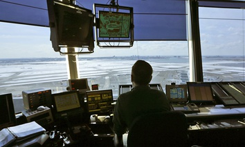 An air traffic controller works in the tower at John F. Kennedy International Airport in New York, Thursday, March 16, 2017.