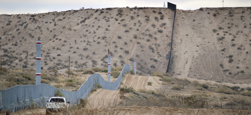 A U.S. Border Patrol agent drives near the U.S.-Mexico border fence in Sunland Park, New Mexico.