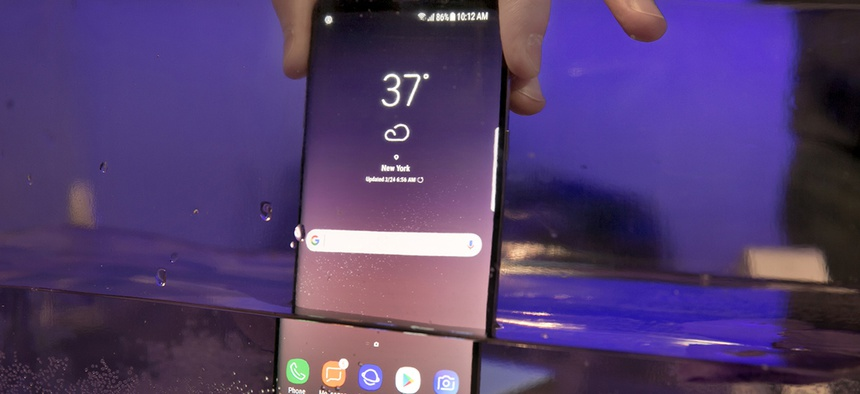A Samsung Galaxy S8 mobile phone is shown partially submerged to demonstrate its water resistance, in New York, March 24, 2017.