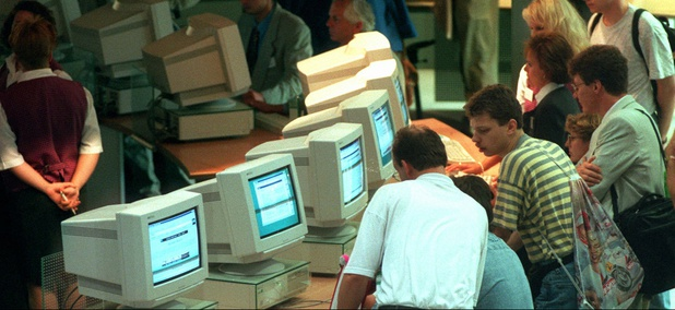 Visitors crowd the computers at the international Electronic Fair in Berlin in August 1995.