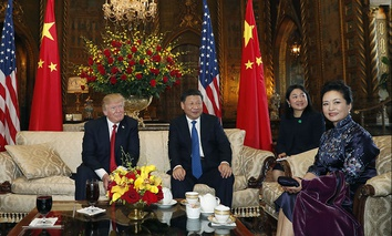 President Donald Trump and Chinese President Xi Jinping, sit with their wives, first lady Melania Trump, left, and Chinese first lady Peng Liyuan, right, before a meeting at Mar-a-Lago, April 6, 2017.
