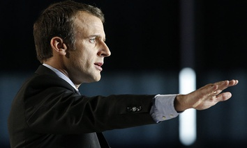 French presidential candidate Emmanuel Macron addresses his supporters during an election campaign rally in Arras, northern France.