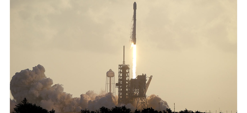 A Falcon 9 SpaceX rocket carrying a classified satellite for the National Reconnaissance Office lifts off from pad 39A at the Kennedy Space Center in Cape Canaveral, Fla.