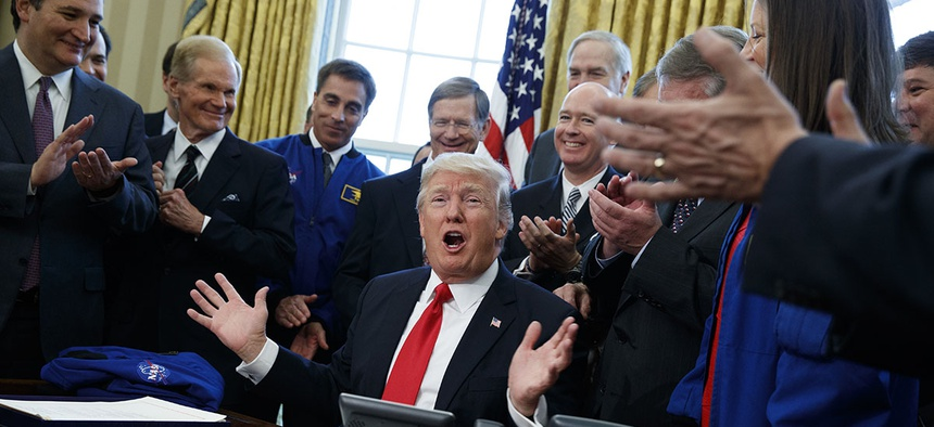 President Donald Trump speaks in the Oval Office of the White House in Washington, Tuesday, March 21, 2017, after signing a bill to increase NASA's budget to $19.5 billion and directs the agency to focus human exploration of deep space and Mars.