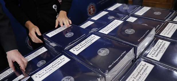 Senate Budget Committee staff members lay out copies of President Donald Trump's fiscal 2018 federal budget for distribution on Capitol Hill, May 23, 2017.