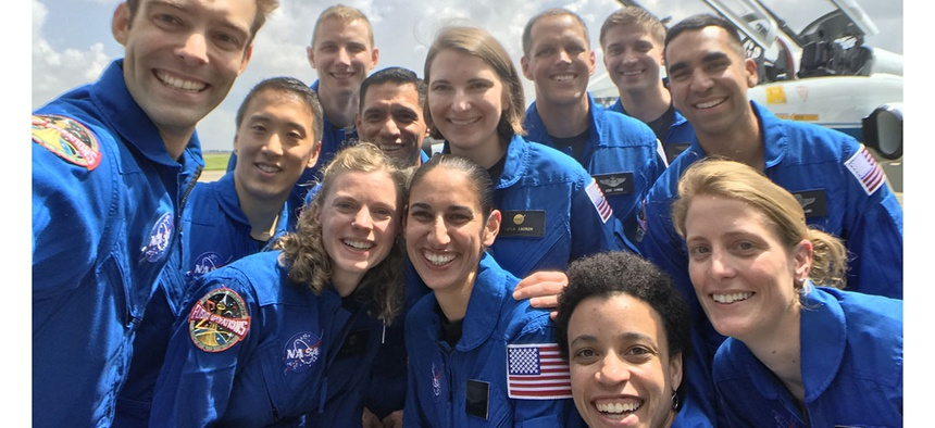 NASA's 2017 Astronaut Candidate Class stopped for a group photo while getting fitted for flight suits at Ellington Airport near NASA's Johnson Space Center in Houston.