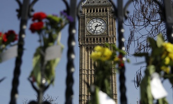 Floral tributes to the victims of the Westminster terrorist attack are placed outside the Palace of Westminster, London, Monday March 27, 2017.