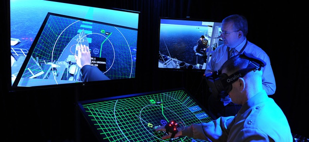 Jim Blesse, standing, from the Office of Naval Research (ONR), explains project BlueShark to Lt. Col. John Moore from the Marine Corps Warfighting Laboratory.
