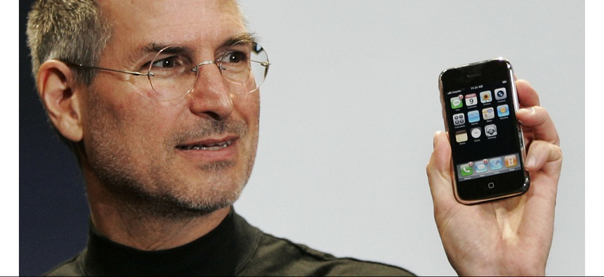 Then-Apple CEO Steve Jobs demonstrates the new iPhone during his keynote address at MacWorld Conference in 2007.