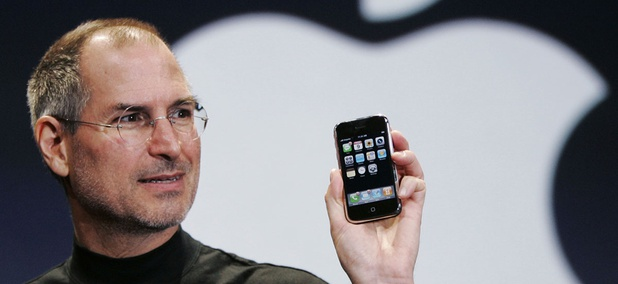 Apple CEO Steve Jobs holds up an Apple iPhone at the MacWorld Conference in San Francisco in 2007.